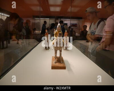 Beijing, China. 10th July, 2019. Photo taken with a mobile phone shows people visiting a Xinjiang relics exhibition in the National Museum of China in Beijing, capital of China, July 10, 2019. Credit: Ma Yan/Xinhua/Alamy Live News - Stock Photo