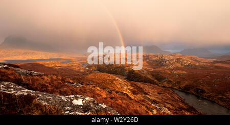 Rain shower with rainbow, North West Highlands - Stock Photo