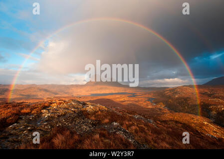 Dramatic rainbow over Suilven mountain, Sutherland - Stock Photo