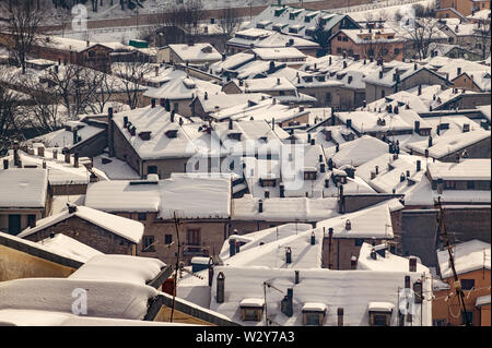 Aerial view of the beautiful snow-covered village of Perscasseroli, Abruzzo Lazio and Molise National Park - Stock Photo