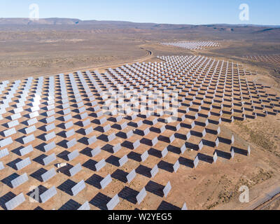 Aerial over solar panels in a dry landscape - Stock Photo