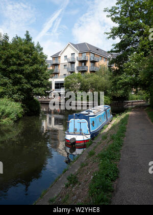 Canal boats, or narrowboats or longboats moored at Hockerill Cut on the River Stort at Bishops Stortford Hertfordshire UK - Stock Photo