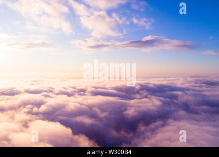 Aerial view White clouds in blue sky. Top view. View from drone. Aerial bird's eye view. Aerial top view cloudscape. Texture of clouds. View from abov - Stock Photo