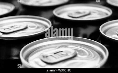 Close up photo of aluminum cans in a raw. Aluminium can background. Can Pattern. Aluminum beverage cans. Drink can. Metal containers for packaging dri - Stock Photo