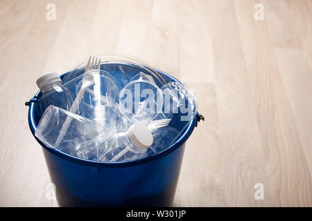 clean recyclable plastic bottles, containers, cups in garbage bin. waste management plastic reuse - Stock Photo