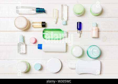 Group of plastic bodycare bottle Flat lay composition with cosmetic products on wooden background empty space for you design. Set of White Cosmetic co - Stock Photo