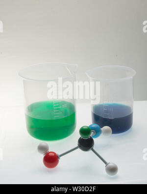 Molecule with various aspects of its compents and liquids in beakers. - Stock Photo