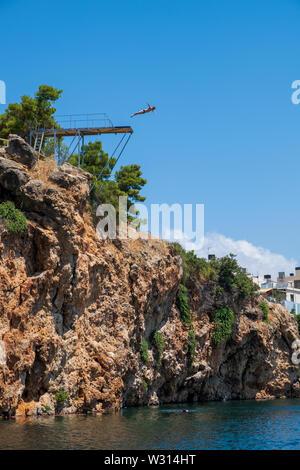 Cliff diving in Agios Nikolaos, Crete - Stock Photo
