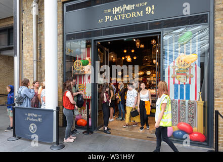 Kings Cross Station Harry Potter shop at Platform 9 3/4, Kings Cross Rail station, London UK - Stock Photo