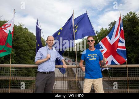 Cardiff, Wales, UK, July 11th 2019. Anti-Brexit protesters deliver their message to passing motorists during the evening rush hour at Culverhouse Cross, a major road artery into and out of the city. Credit: Mark Hawkins/Alamy Live News - Stock Photo