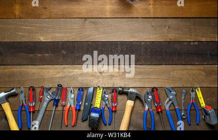 Working tools on wooden background - Stock Photo