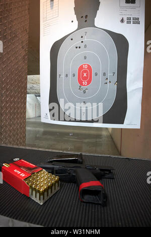 heckler and koch 45 handgun with bullets and target gun range USA United States of America - Stock Photo