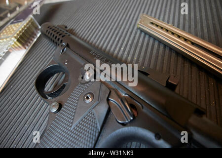 ruger mkiv .22 lr pistol with bullets magazine and target at a gun range USA United States of America - Stock Photo