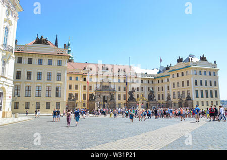 Prague, Czech Republic - June 27th 2019: Tourists in front of famous Prague Castle on Hradcany Square, in Czech Hradcanske namesti. Sightseeing. Seat of Czech president. Popular tourist place. - Stock Photo