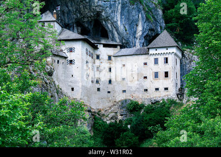 Predjama Castle, a medieval castle, built in the mouth of a cave on a cliff face near Postojna in Slovenia - Stock Photo