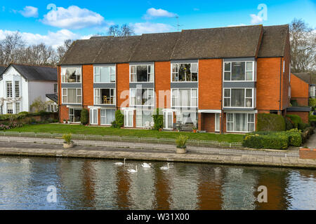 MARLOW, ENGLAND - MARCH 2019: Block of modern flats on the bank of the River Thames in Marlow. - Stock Photo