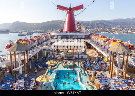 ENSENADA, MEXICO - MAY, 31, 2015: An aerial view of a cruise ship Carnival Inspiration pool area in Ensenada port - Stock Photo