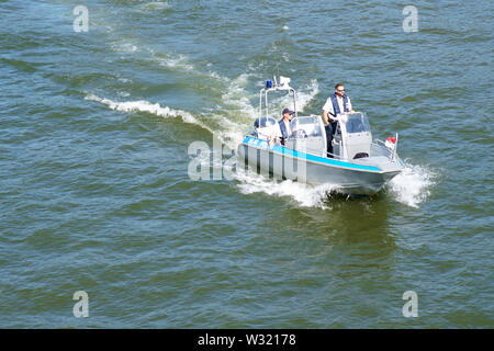 Frankfurt, Germany - July 06, 2019: The top view of a police boat on patrol on the River Main on July 06, 2019 in Frankfurt. - Stock Photo