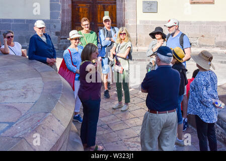 Group of tourists on a  guided tour , San Miguel de Allende, Mexico - Stock Photo