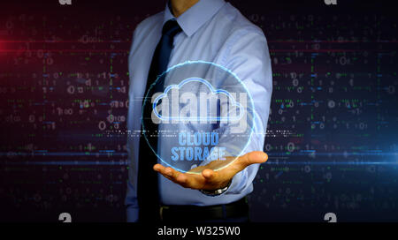 Man with data cloud storage symbol hologram on hand. Businessman showing futuristic concept of digital computing, files storage and online servers wit - Stock Photo