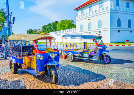 BANGKOK, THAILAND - APRIL 22, 2019: A tuk tuk ride along the busy streets of the city is one of the most exciting adventures in central district, on A - Stock Photo