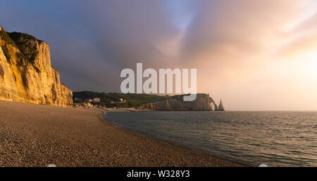 Scenic landscape of Etretat cliffs, falaise d'Aval, at dusk or sunset, natural landmark of Normandy Coast, France. - Stock Photo