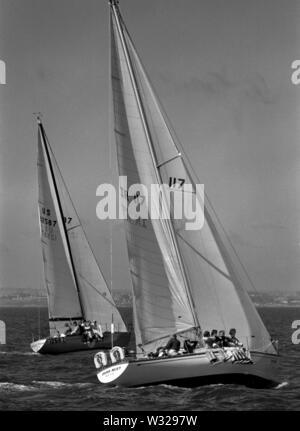 AJAXNETPHOTO. JULY, 1974. TORBAY, ENGLAND. - ONE TON CUP WORLDS -IRISH MIST (IR 117) AND KING OF PRUSSIA (US 12587).PHOTO:JONATHAN EASTLAND/AJAXREF:742073B - Stock Photo