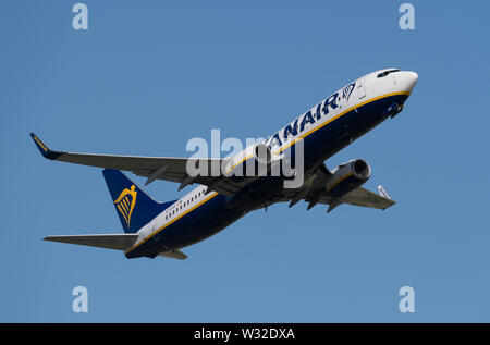 A Ryanair Boeing 737-800 takes off from Manchester International Airport (Editorial use only) - Stock Photo