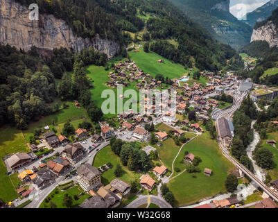 Beautiful Staubbachfall waterfall flowing down the picturesque Lauterbrunnen valley and village in Bern canton, Switzerland, Europe - Stock Photo