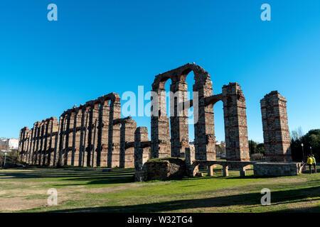 Acueducto de los Milagros (Miraculous Aqueduct) located in Merida, Spain - Stock Photo