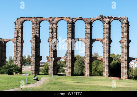 A panoramic of the Acueducto de los Milagros (Miraculous Aqueduct) located in Merida, Spain - Stock Photo