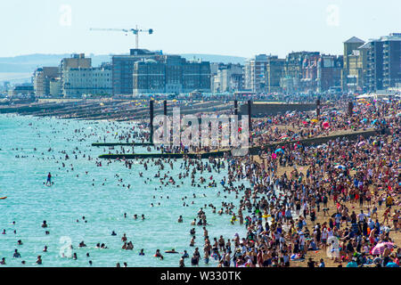 UK June 29th, 2019 Brighton beach, Brighton and Hove, East Sussex, England. Thousands of people relax on the sun. - Stock Photo