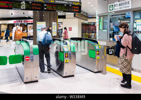 Utsunomiya, Japan - April 4, 2019: Turnstile automatic entry or entrance to Shinkansen bullet train transfer to Tokyo with people by ticket office in - Stock Photo