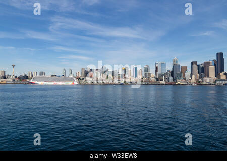 United States of America, USA, Washington, Seattle, 11th of May 2019. View from a ferry across Puget Sound on the city skyline and a cruise ship Stock Photo