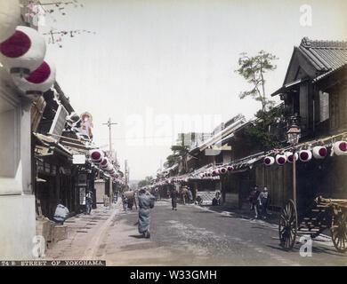 [ 1890s Japan - Bentendori, Yokohama ] —   Paper lanterns decorate Bentendori in Yokohama, Kanagawa Prefecture. During the Meiji Period (1868-1912), this was Yokohama's premier shopping street.  19th century vintage albumen photograph. - Stock Photo
