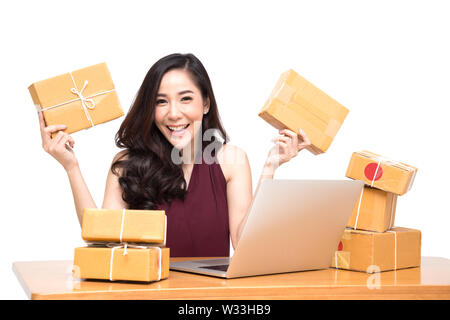 Young asian women with startup small business entrepreneur freelance working at home and excited about the orders of many customers, Online marketing - Stock Photo