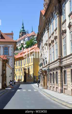 Prague, Czech Republic - June 27th 2019: Beautiful streets in Mala Strana, Lesser Town of Prague. Historical center of the Czech capital. Prague Castle in background. Amazing cities, Europe. - Stock Photo