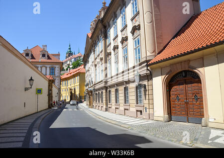 Prague, Czech Republic - June 27th 2019: Historical old town streets in Mala Strana, Lesser Town of Prague. Beautiful center of Czech capital. Prague Castle in background. Cityscape, Praha, Czechia. - Stock Photo