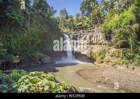 Tegenungan Waterfall near Ubud, Bali, Indonesia. Tegenungan Waterfall is a popular destination for tourists visiting Bali, Indonesia - Stock Photo