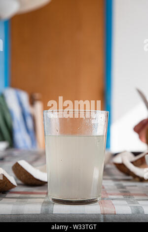 Coconut water and fresh pieces coconut on the table. Exotic food form Dominican Republic - Stock Photo