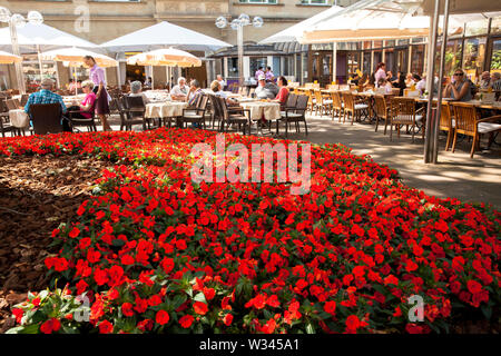 terrace of the Cafe Reichard near the cathedral, Cologne, Germany.  Terrasse des Cafe Reichard am Dom, Koeln, Deutschland. - Stock Photo
