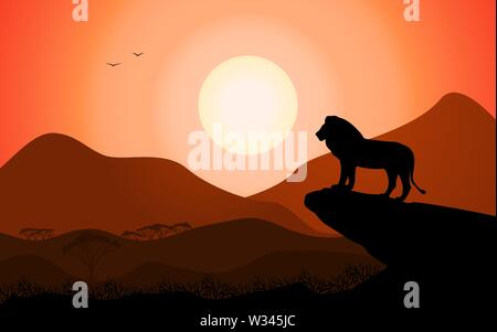 Lion king standing on a rock against a sunset - Stock Photo