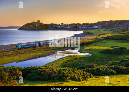 Summers evening last train of the day at Criccieth, North Wales. - Stock Photo