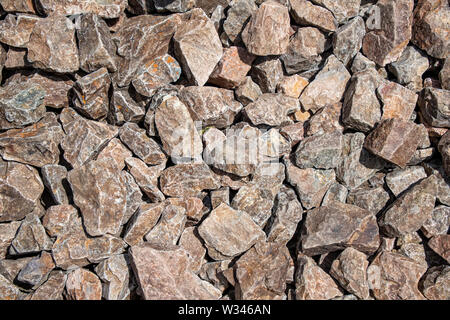 Background from fragments of granite stones close up. - Stock Photo