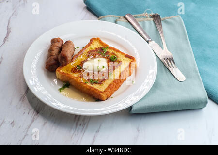 Classic American breakfast french toast with maple syrup served with side of sausage links - Stock Photo