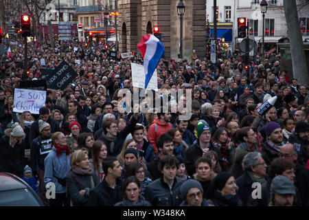 Paris, France - January 11, 2015: the Je Suis Charlie demonstration at Paris, in respect to the victims of the terrorist attack - Stock Photo