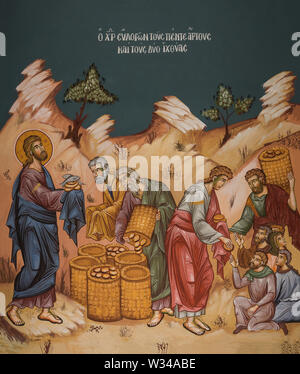 Orthodox icon of Jesus multiplying loaves of bread and fish - Stock Photo