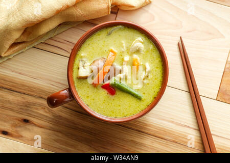 Spicy green thai curry with chicken and vegetables - Stock Photo