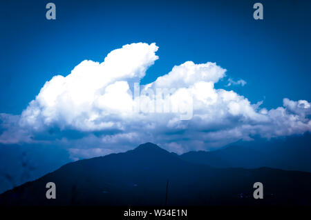 Background photo of Cloudy overcast morning at himalayan mountains. Dreamy landscape. Fluffy weather. Beauty of wild east asian indian nature. Magnifi