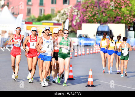 Naples, Italy. 12th July, 2019. Athletes compete during the final match of Men's and Women's 20km Walk at the 30th Summer Universiade in Naples, Italy, July 12, 2019. Credit: Kong Hui/Xinhua/Alamy Live News - Stock Photo
